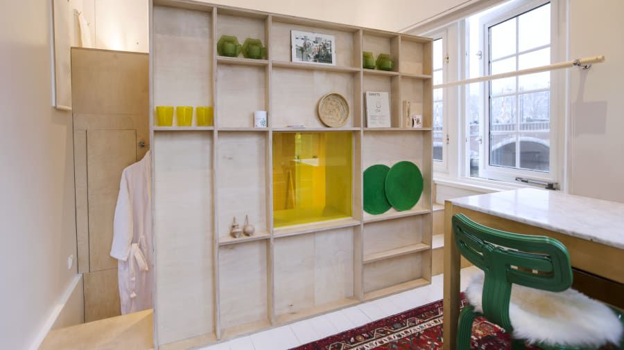 Colorful interior with shelving unit