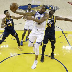 Golden State Warriors forward Andre Iguodala (9) shoots in front of Utah Jazz center Ekpe Udoh (33) during the second half of an NBA basketball game in Oakland, Calif., Wednesday, Dec. 27, 2017. The Warriors won 126-101. (AP Photo/Jeff Chiu)