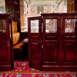 The restaurant has four booths, called snugs, with leather banquettes and doors for privacy.