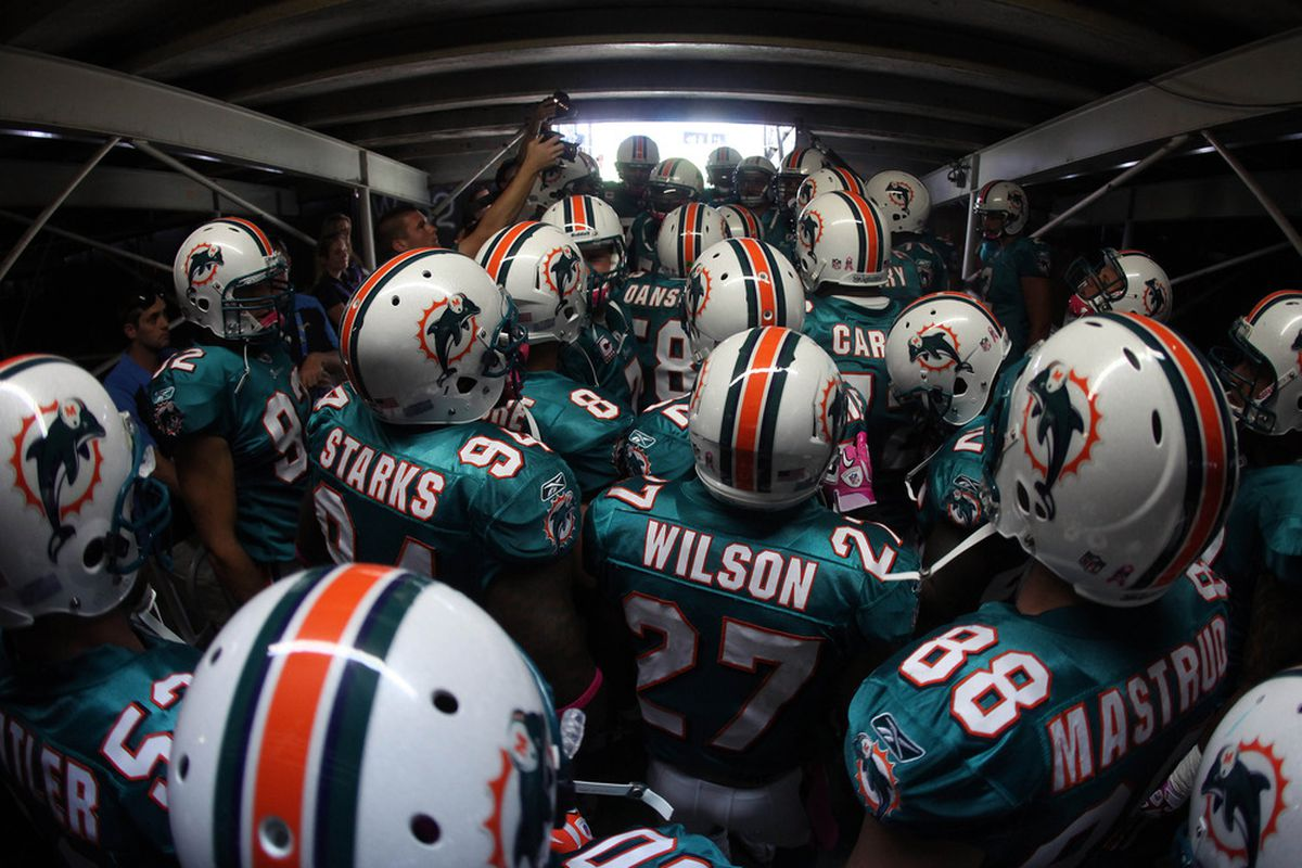 SAN DIEGO, CA - OCTOBER 2:  The Miami Dolphins prepare to enter the game against  the San Diego Chargers during their NFL Game on October 2, 2011 at Qualcomm Stadium in San DIego, California. (Photo by Donald Miralle/Getty Images)