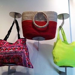 There's a wide range of bright bags. That neon one in the corner is $109.50.
