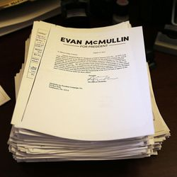 Signatures are placed on a desk after being delivered to the lieutenant governor's office at the Capitol in Salt Lake City on Monday, Aug. 15, 2016. The signatures are for a petition to put independent presidential candidate Evan McMullin on the ballot in Utah in November. Although 1,000 signatures were needed, more than 2,000 were obtained and delivered.