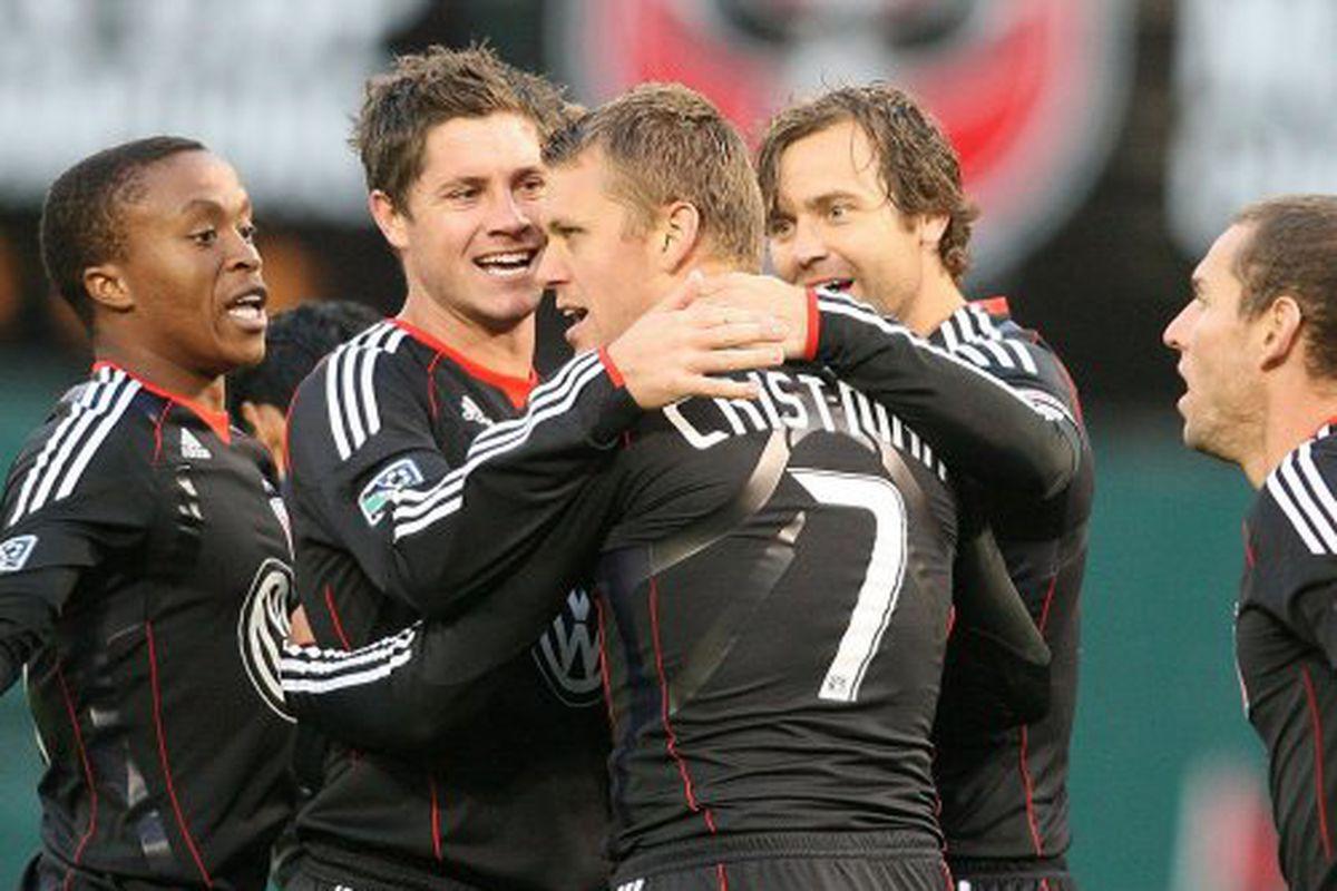 "Adam Cristman celebrates his two goal performance with his teammates.  Photo via <a href=""http://www.dcunited.com/sites/default/files/imagecache/primary_image-620x350/image_nodes/2010/04/4564092450_6663e1c944_b.jpg"">dcunited.com</a>"