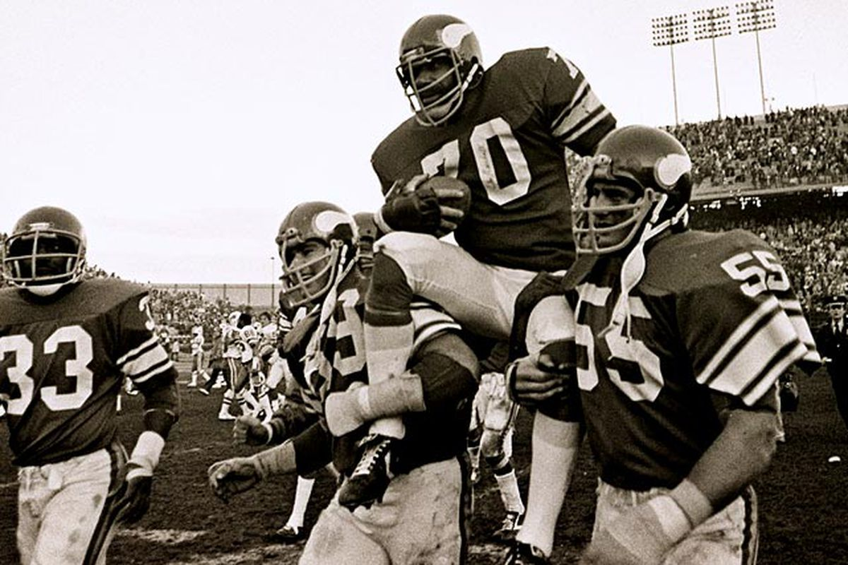 Jim Marshall being carried off the field after his last game as a Minnesota Viking.