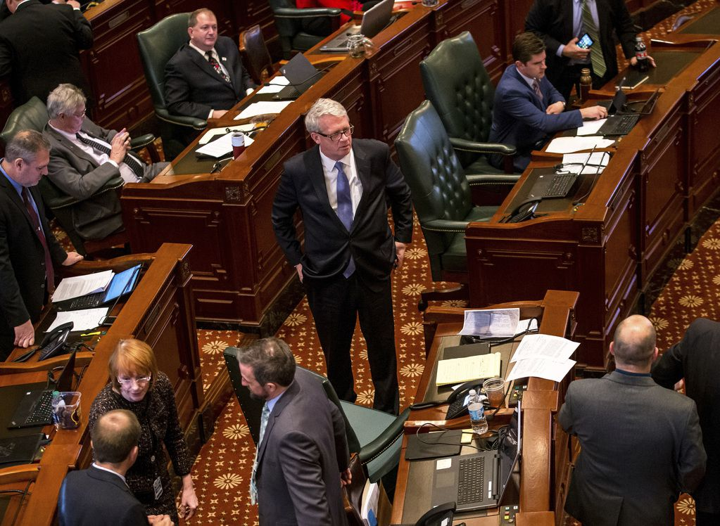 State House Minority Leader Jim Durkin, R-Western Springs, stands on the House floor as debate continues at the Illinois State Capitol, Thursday, Feb. 14, 2019, in Springfield. (Justin L. Fowler/The State Journal-Register via AP)
