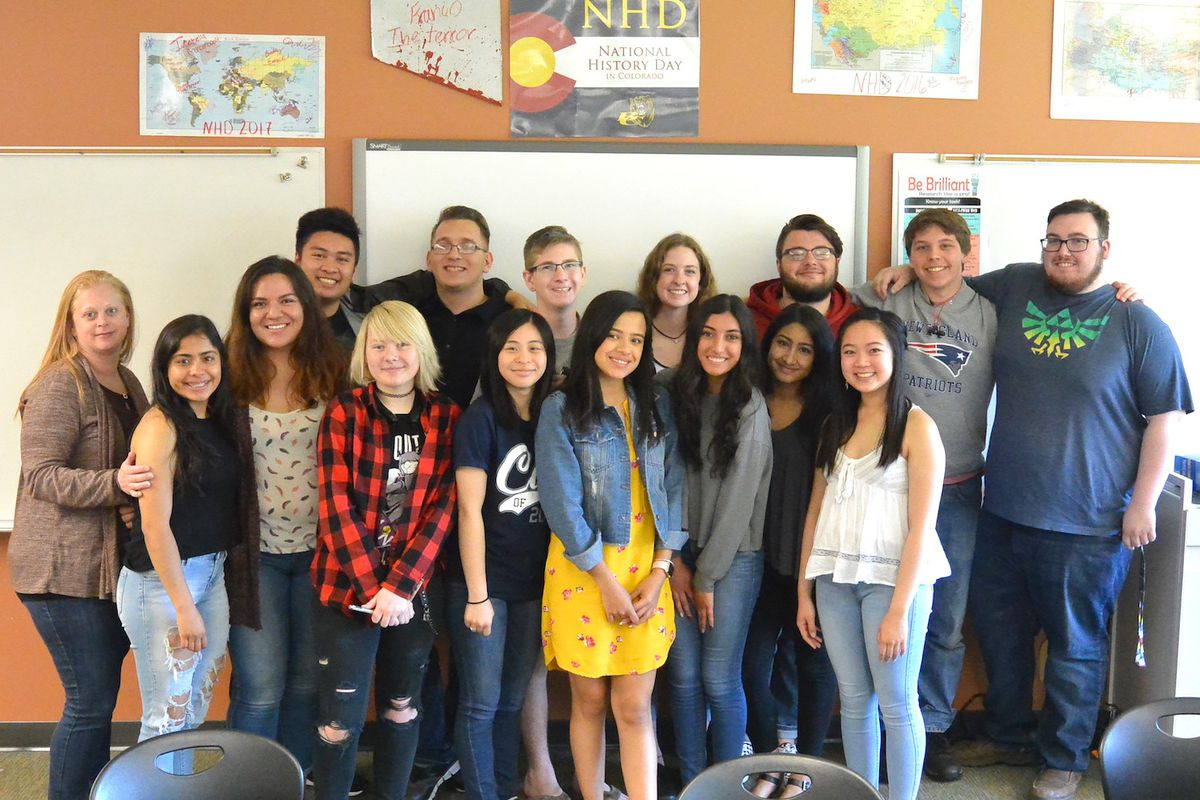 Kelly Cvanciger, at left, poses with students from her AP government class last year.