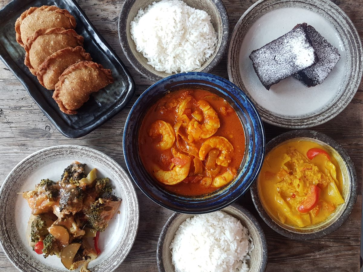Assam prawns, centre, and curry puffs top-left in the meal kit created by Sambal Shiok's Mandy Yin