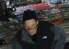 Surveillance image of the man suspected of breaking into two Glen Ellyn businesses Sunday. | Glen Ellyn police