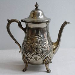 """<a href=""""https://mushmina.myshopify.com/collections/a-mushmina-mothers-day/products/vintage-moroccan-teapot-pewtwe"""">Vintage pewter and brass teapot</a> from Morocco, $110 at South Street's Mushmina."""