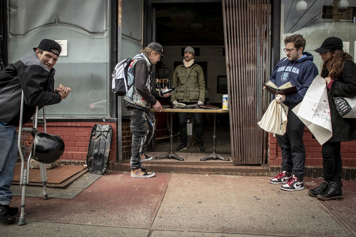 Patrons buy wine outside Hotel Delmano