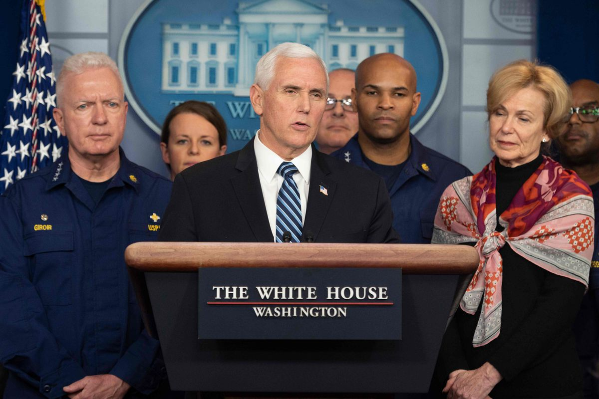 Vice President Mike Pence, standing with members of the White House Coronavirus Task Force team, speaks during a press briefing earlier this week.