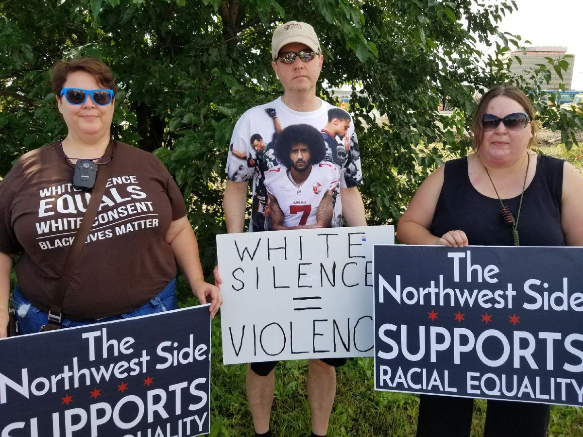 Some of the protesters who joined Rev. Gregory Livingston on Monday morning near the Kennedy Expressway at Cumberland Avenue.   Manny Ramos/Sun-Times