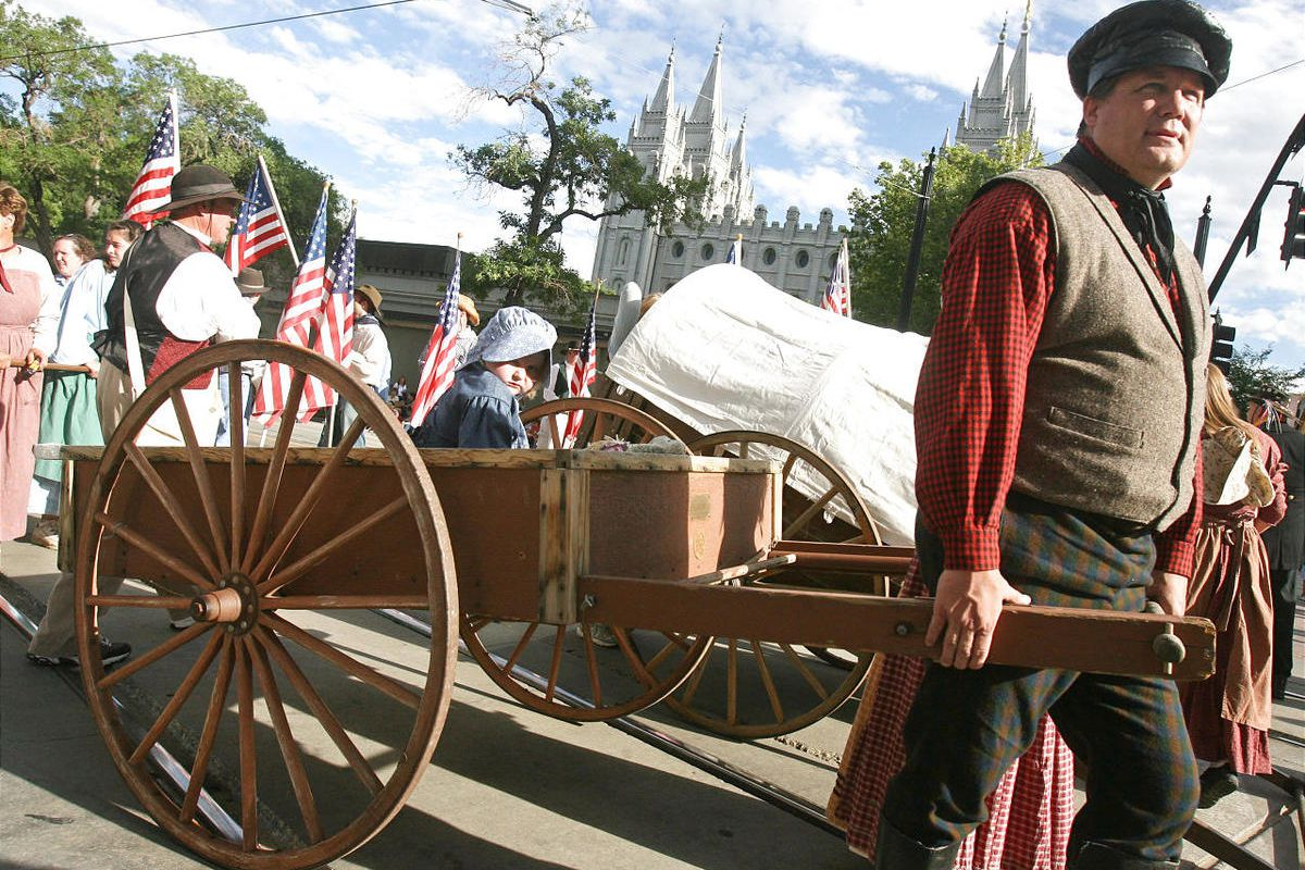 Steve Sorensen (cq) prepares to pull a handcart carrying Mary Gillmore (5) in the Days of '47 parade in Salt Lake City, Utah July 24, 2007.  Photo by Keith Johnson