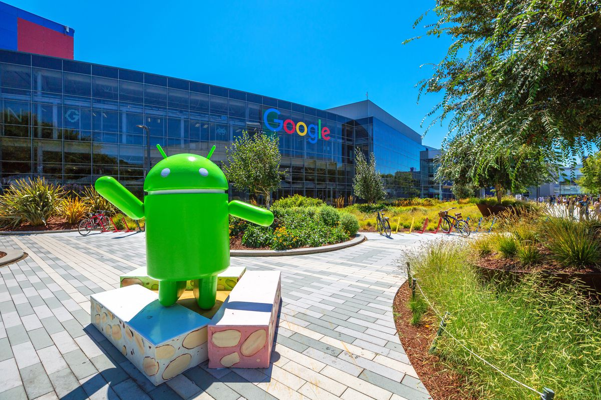 Photo of the main Google campus, with Android mascot statue in foreground.