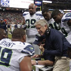 Seattle Seahawks head coach Pete Carroll talks to his team during the first half of an NFL football game against the St. Louis Rams Sunday, Sept. 30, 2012, in St. Louis.