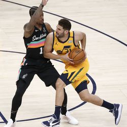 Utah Jazz forward Georges Niang (31) moves around San Antonio Spurs forward DeMar DeRozan (10) during an NBA game at Vivint Smart Home Arena in Salt Lake City on Monday, May 3, 2021. The Jazz won 110-99.