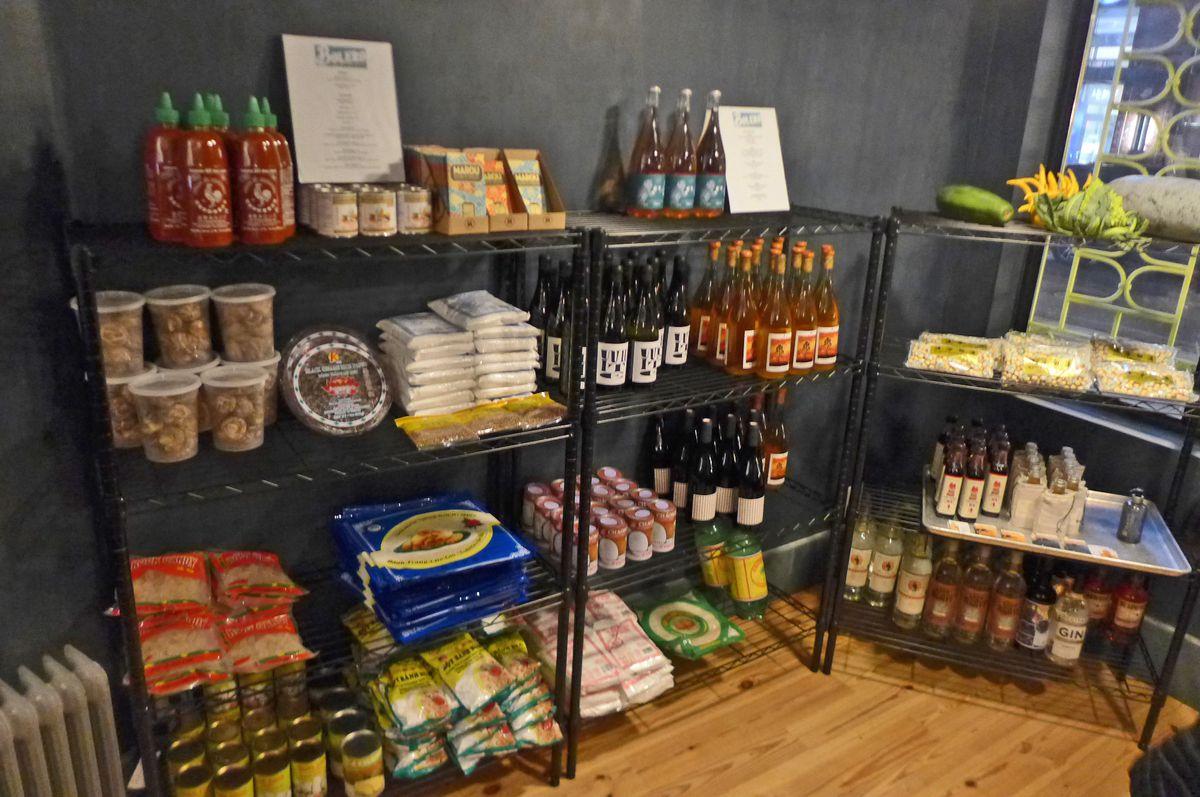 Several shelves of bottled and packaged goods.