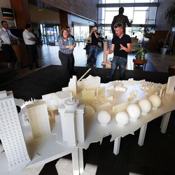 Sculptor Mark Revels, right, answers questions about sugar cube sculptures that map iconic buildings across the country on Monday, July 18, 2016. The sculptures are on display at Intermountain Medical Center in Murray. Revels and fellow sculptor Brendan Jamison displayed their work to raise awareness on how to manage sugar intake for a healthy lifestyle.