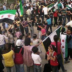 """In this citizen journalism image provided by the Local Coordination Committees in Syria and  taken on Saturday, April 7, 2012, Syrians chant slogans and wave Syrian revolutionary flags during a demonstration in Daraa, Syria.  A U.N.-brokered peace deal for Syria appeared to collapse Sunday April 8, 2012  as the government made a new demand that its opponents provide """"written guarantees"""" to lay down their weapons before regime forces withdraw from cities, a call swiftly rejected by the country's main rebel group."""
