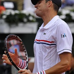 John Isner of US reacts after missing a point during the Davis Cup World Group semifinal tennis match  against Spain's David Ferrer in Gijon, northern Spain, Sunday, Sept. 16 , 2012. Ferrer won 6-7,  6-3,  6-4, 6-2.