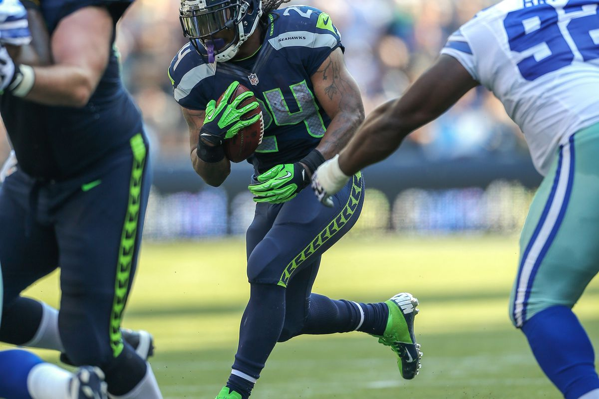 SEATTLE, WA - SEPTEMBER 16:  Running back Marshawn Lynch #24 of the Seattle Seahawks rushes against the Dallas Cowboys at CenturyLink Field on September 16, 2012 in Seattle, Washington.  (Photo by Otto Greule Jr/Getty Images)