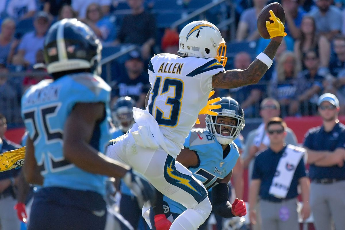 Los Angeles Chargers wide receiver Keenan Allen drops a pass against Tennessee Titans cornerback Adoree' Jackson and Titans cornerback Logan Ryan during the first half at Nissan Stadium.