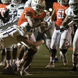 Timpview's Micah Beckstead (14) pushes through Orem's defense to score in the first half at Timpview High in Provo on Thursday, Sept. 30, 2021.