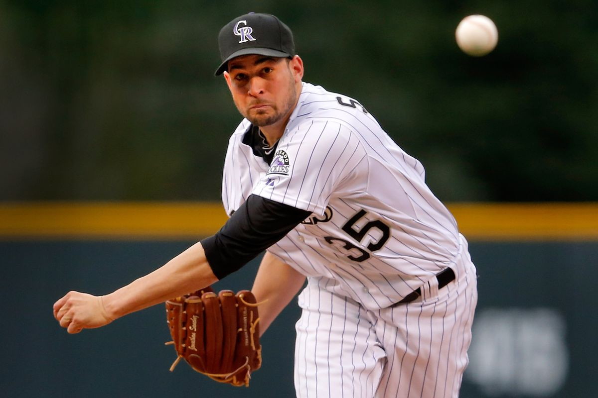 DENVER, CO - AUGUST 03:  Starting pitcher Jonathan Sanchez #35 of the Colorado Rockies delivers against the San Francisco Giantsat Coors Field on August 3, 2012 in Denver, Colorado.  (Photo by Doug Pensinger/Getty Images)