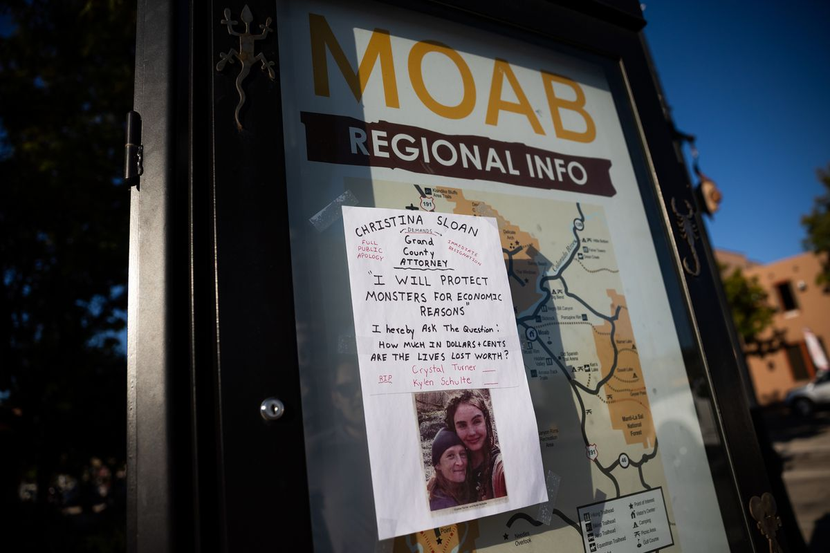 A sign critical of the Grand County attorney features a photograph of Kylen Schulte and Crystal Turner in Moab on Friday, Sept. 17, 2021.