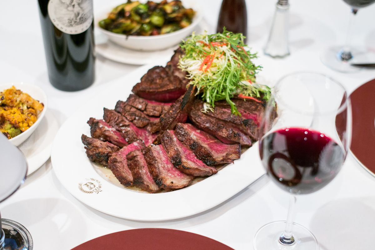 A steak, cooked rare and cut into pieces