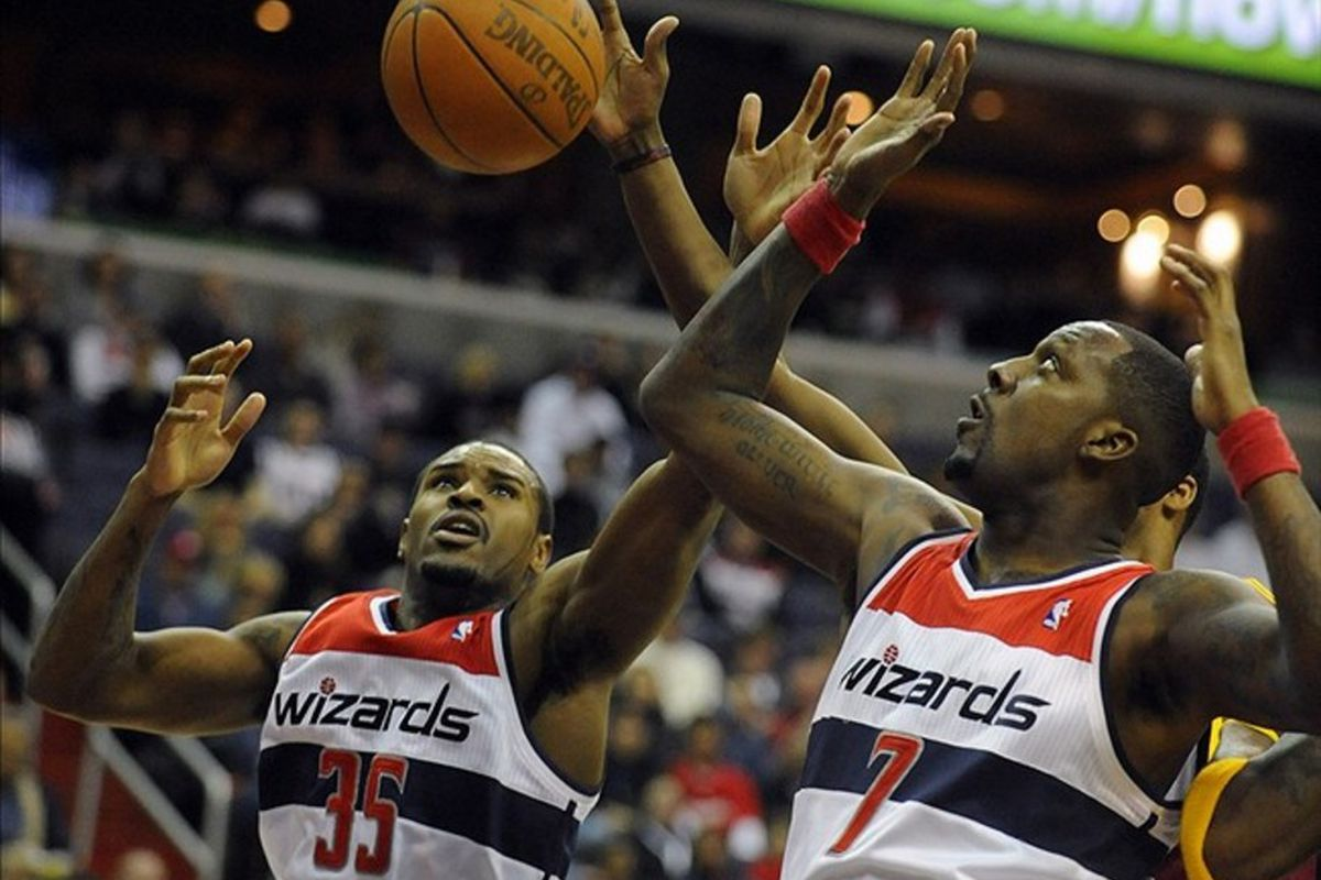Mar 3, 2012; Washington, DC, USA; Washington Wizards forward Trevor Booker (35) and forward Andray Blatche (7) fight for a rebound during the first half against the Cleveland Cavaliers at the Verizon Center. Mandatory Credit: Brad Mills-US PRESSWIRE
