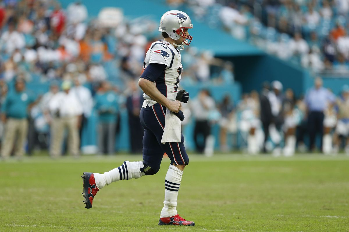 Tom Brady of the New England Patriots reacts against the Miami Dolphins at Hard Rock Stadium on December 9, 2018 in Miami, Florida.