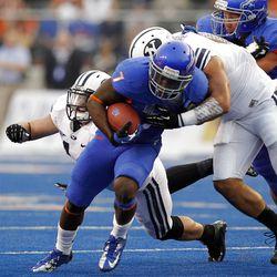 D.J. Harper of the Boise State Broncos runs the ball during NCAA football in Boise, Thursday, Sept. 20, 2012.