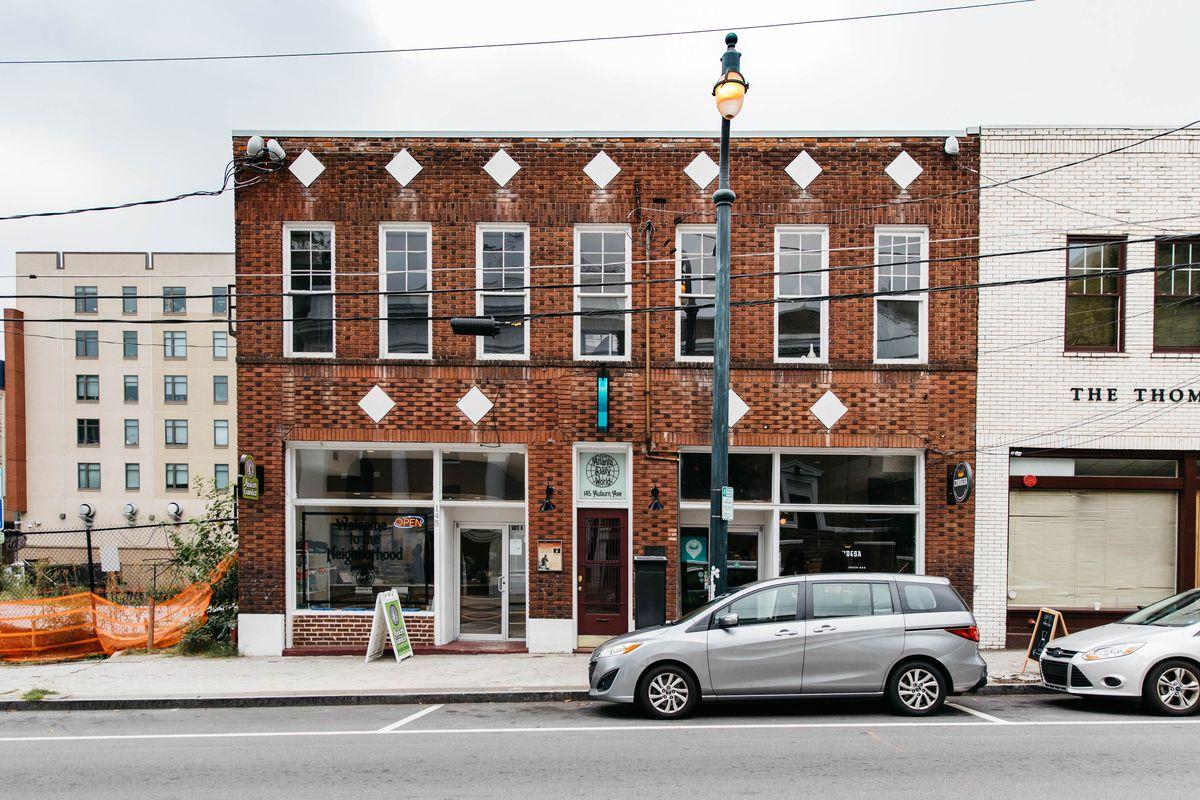 A shot looking toward the brick, two-story Atlanta Daily World building on Auburn Avenue