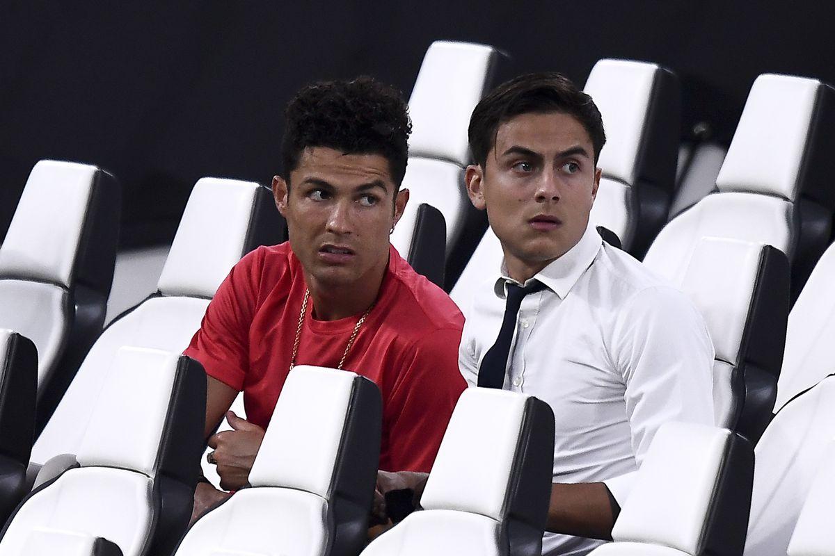 Cristiano Ronaldo (L) and Paulo Dybala of Juventus FC attend...