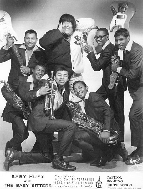 """Melvyn """"Deacon"""" Jones, kneeling in front with trumpet, and the rest of Baby Huey and the Babysitters."""