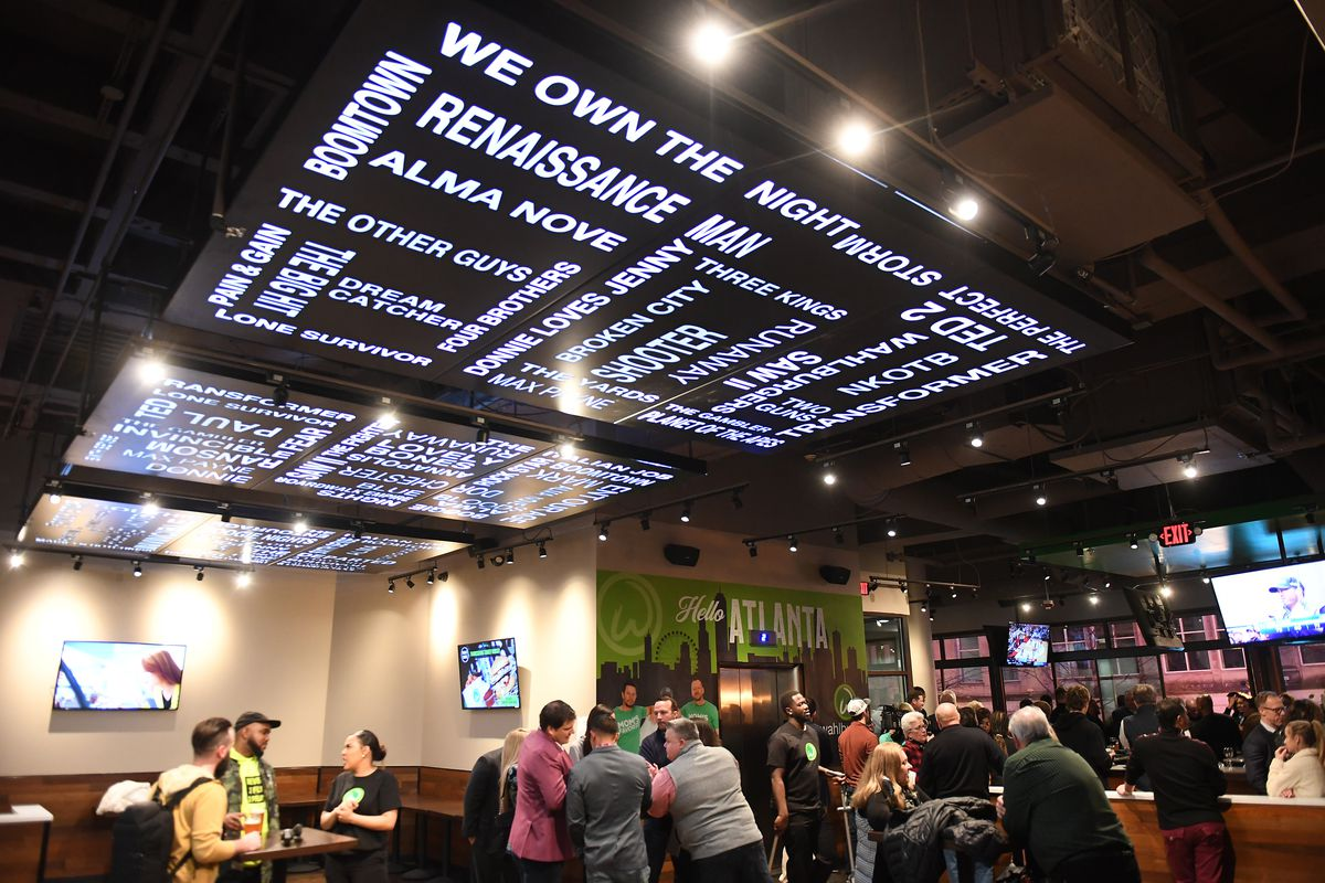 The interior of Wahlburgers in downtown Atlanta with a crowd for a media preview