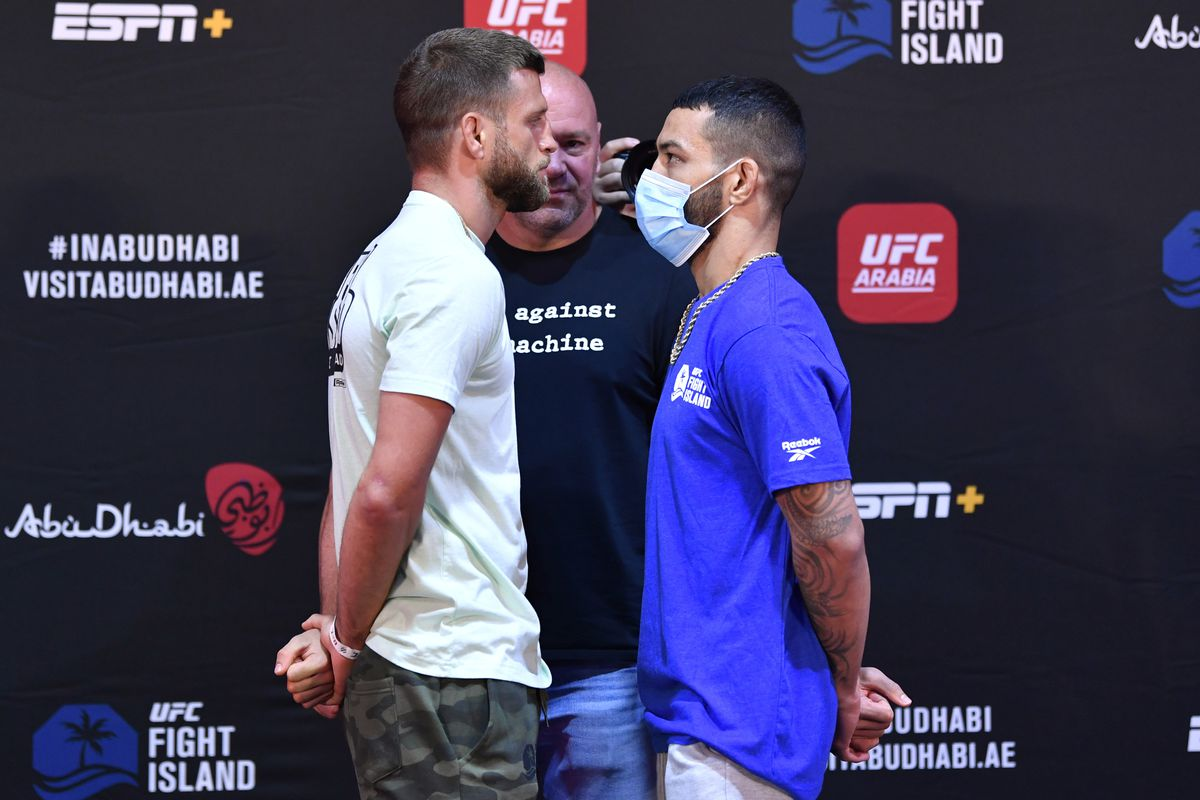 Opponents Calvin Kattar and Dan Ige face off during the UFC Fight Night weigh-in inside Flash Forum on UFC Fight Island on July 14, 2020 in Yas Island, Abu Dhabi, United Arab Emirates.