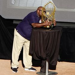 Al Newman showing the Commissioner's Trophy some love