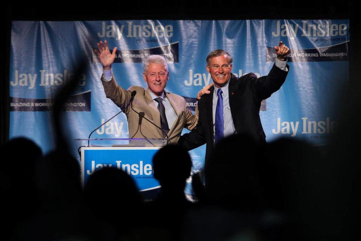 The crowd is on their feet and cheering after Former President Bill Clinton and gubernatorial candidate Jay Inslee spoke at a fundraiser Saturday, Sept. 15, 2012 at the Washington State Convention Center in Seattle.  Over 3,000 tickets were sold for the e