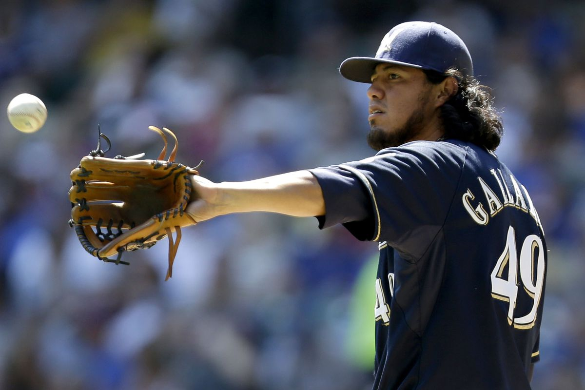 MILWAUKEE, WI - AUGUST 22: Yovani Gallardo #49 of the Milwaukee Brewers pitches against the Chicago Cubs during the game at Miller Park on August 22, 2012 in Milwaukee, Wisconsin. (Photo by Mike McGinnis/Getty Images)