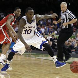 Kansas guard Tyshawn Taylor (10) chases a loose ball past Ohio State guard William Buford during the second half of an NCAA Final Four semifinal college basketball tournament game Saturday, March 31, 2012, in New Orleans.