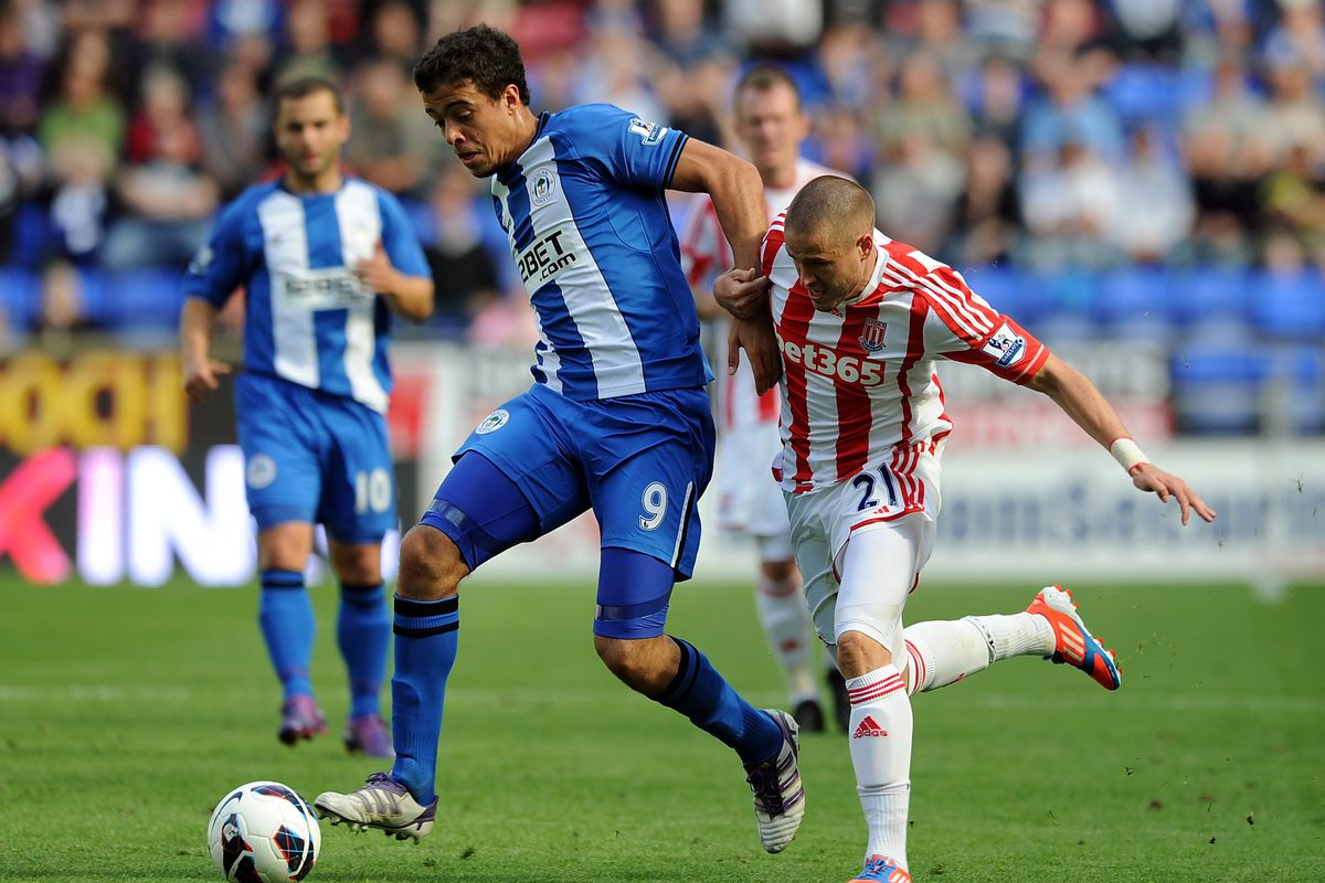 Franco Di Santo of Wigan Athletic in action with Michael Kightly of Stoke City during the Barclays Premier League match between Wigan Athletic and Stoke City at DW Stadium.