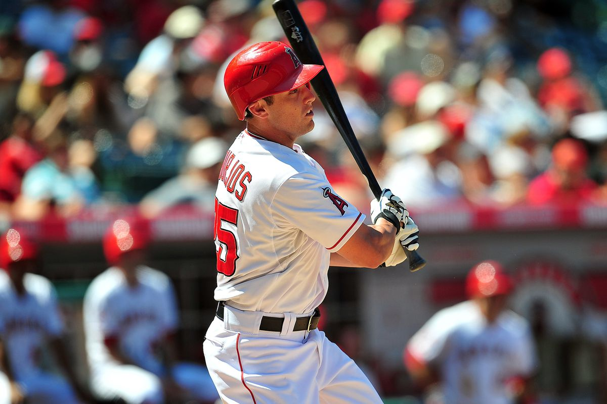 July 25, 2012; Anaheim, CA, USA; Los Angeles Angels center fielder Peter Bourjos (25) hits a single in the eighth inning against the Kansas City Royals at Angel Stadium. Mandatory Credit: Gary A. Vasquez-US PRESSWIRE
