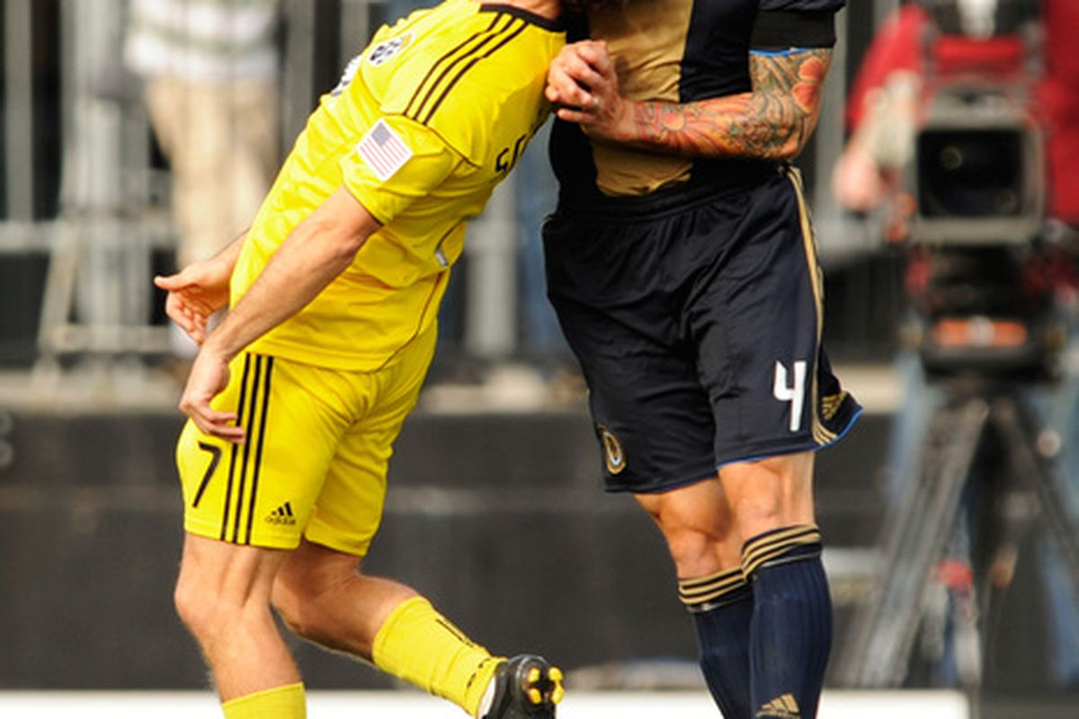 COLUMBUS OH - OCTOBER 24:  Guillermo Barros Schelotto #7 of the Columbus Crew and Danny Califf #4 of the Philadelphia Union battle for control of a header ball on October 24 2010 at Crew Stadium in Columbus Ohio.  (Photo by Jamie Sabau/Getty Images)