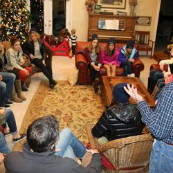 Steve Aldana conducts a Hands for Cosmas committee meeting at his home in Mapleton. The committee is trying to raise nearly $30,000 for a Ugandan man named Opedmoth Cosmas to get prosthetic hands. Cosmas' hands were amputated after they were caught in a grinding machine in January.