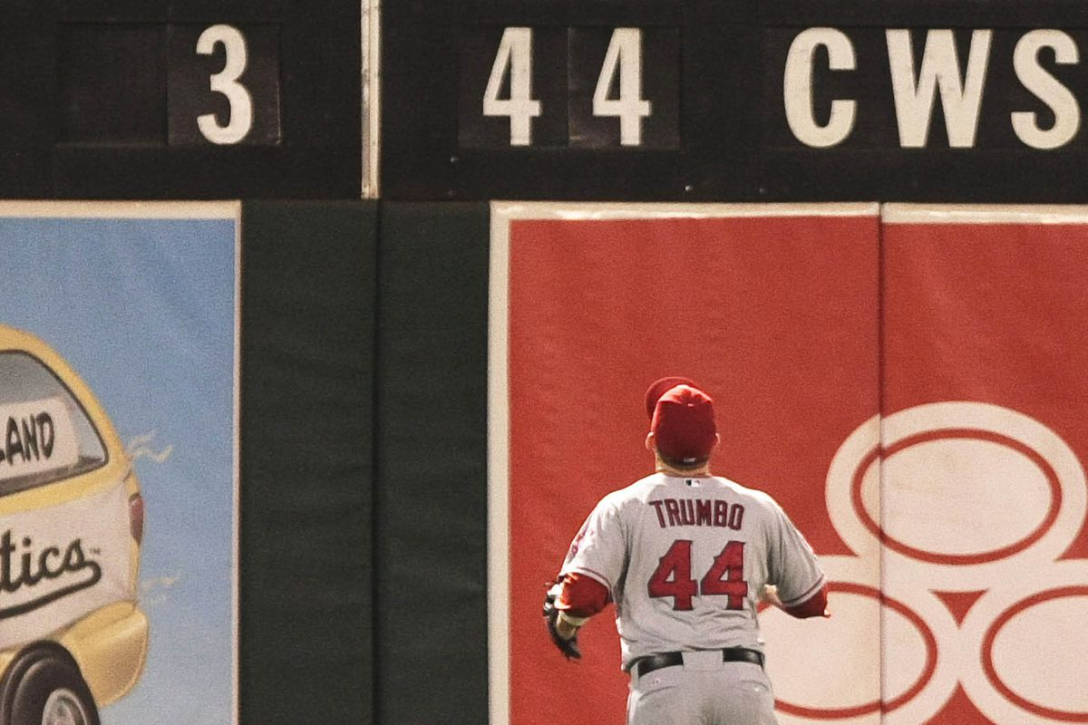 August 7, 2012; Oakland, CA, USA; Los Angeles Angels left fielder Mark Trumbo (44) watches the ball bounce off the wall for a home run by the Oakland Athletics during the sixth inning at O.co Coliseum. Mandatory Credit: Kelley L Cox-US PRESSWIRE