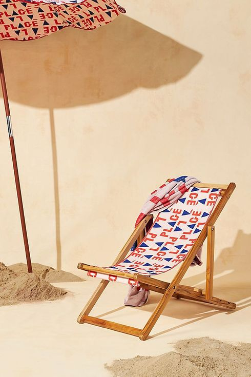 Wooden folding chair with graphic print seat.