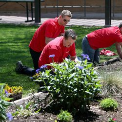 Key Bank employees work in the GEM Court Garden of the George E. Wahlen Department of Veterans Affairs Medical Center at Key Bank's national Neighbors Make The Difference Day in Salt Lake City on Wednesday, May 14, 2014. Nearly 7,000 bank employees, across the country and in Utah, will spend the afternoon volunteering for a wide array of community service projects.