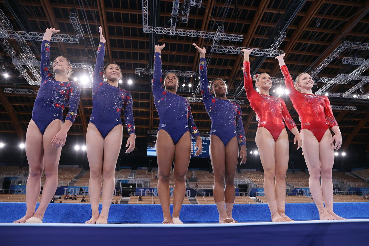 Grace McCullum, Sunisa Lee, Jordan Chiles, Simone Biles, Mykayla Skinner and Jade Carey of Team USA wave as they line up ahead of their floor routines on day two of the Tokyo 2020 Olympic Games at Ariake Gymnastics Centre on July 25, 2021 in Tokyo, Japan.